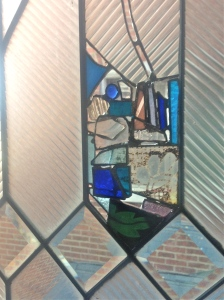 Working with new and antique glass, I filled in the damaged sections, and stabilized the remaining glass.