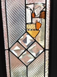 I backed the leaded glass with insulated glass panels, which reduced the airflow in the living room, and provided additional structure.